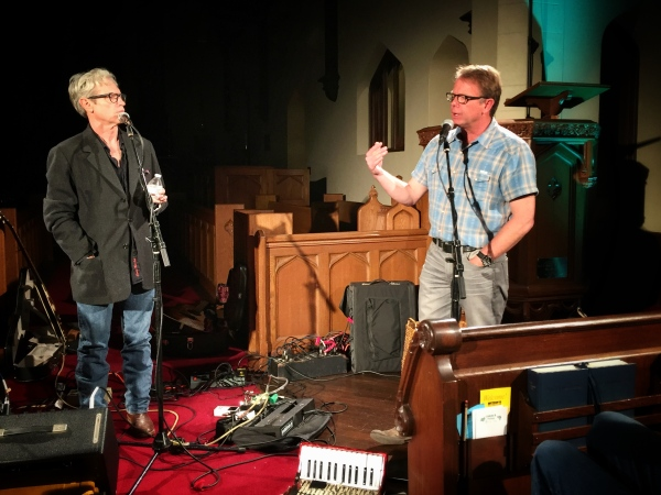 Sam Baker and Stephen Kinney discussing life, love and grace at the March Unplugged on the Front Porch Concert.